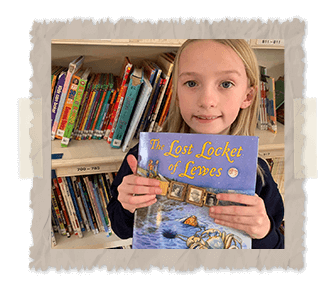 little girl holding the lost locket of lewes book