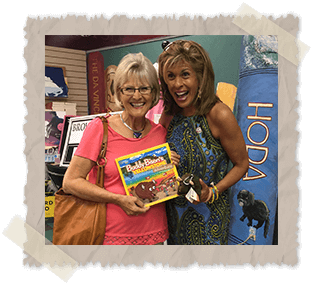 Ilona and Hoda holding Buddy Bison book